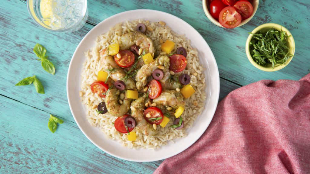 pesto shrimp over garlic and olive oil rice