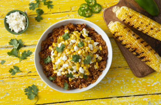 Mexican street corn rice bowl with beans and feta cheese