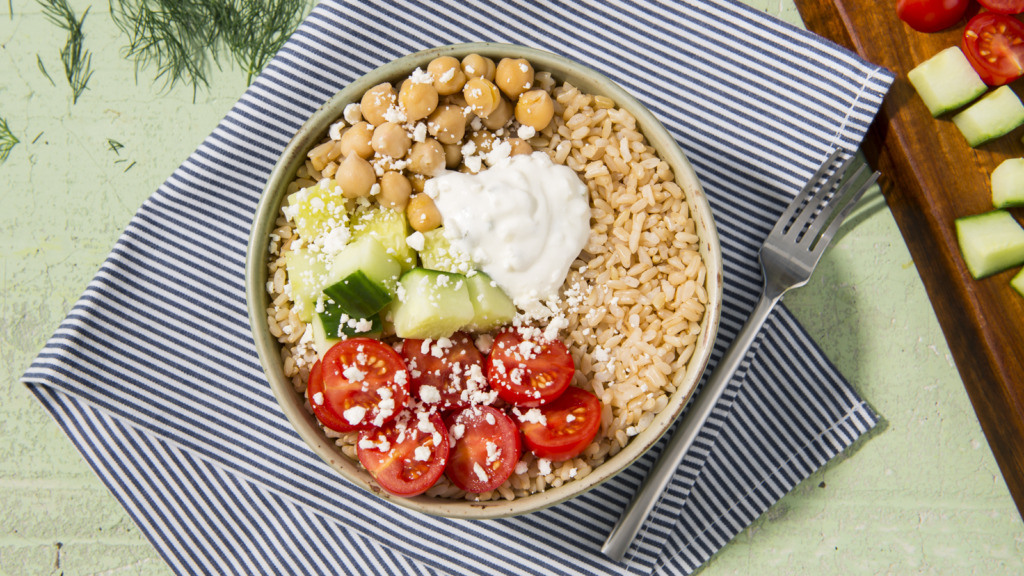Greek-inspired rice bowl with chickpeas, brown rice, tomatoes and tzatziki sauce