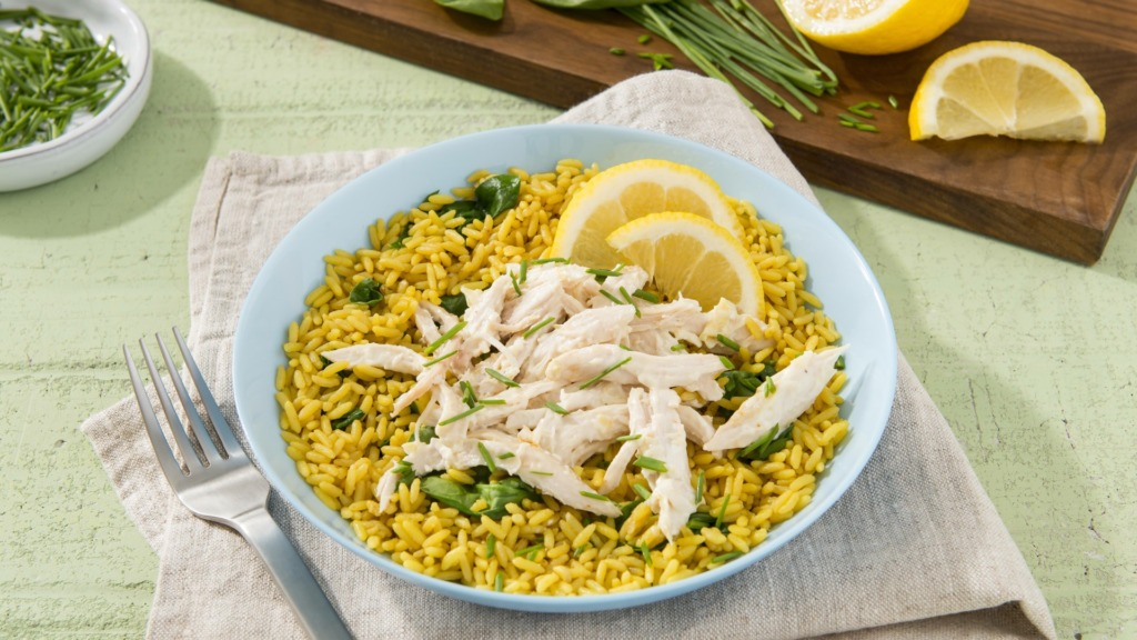 Chicken-and-rice-dish-with-artichoke-and-asiago-dip-and-lime-wedges