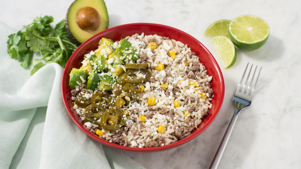 Rice-bowl-with-white-rice-mexican-style-corn-beef-and-crumbled-feta-cheese-and-avocado