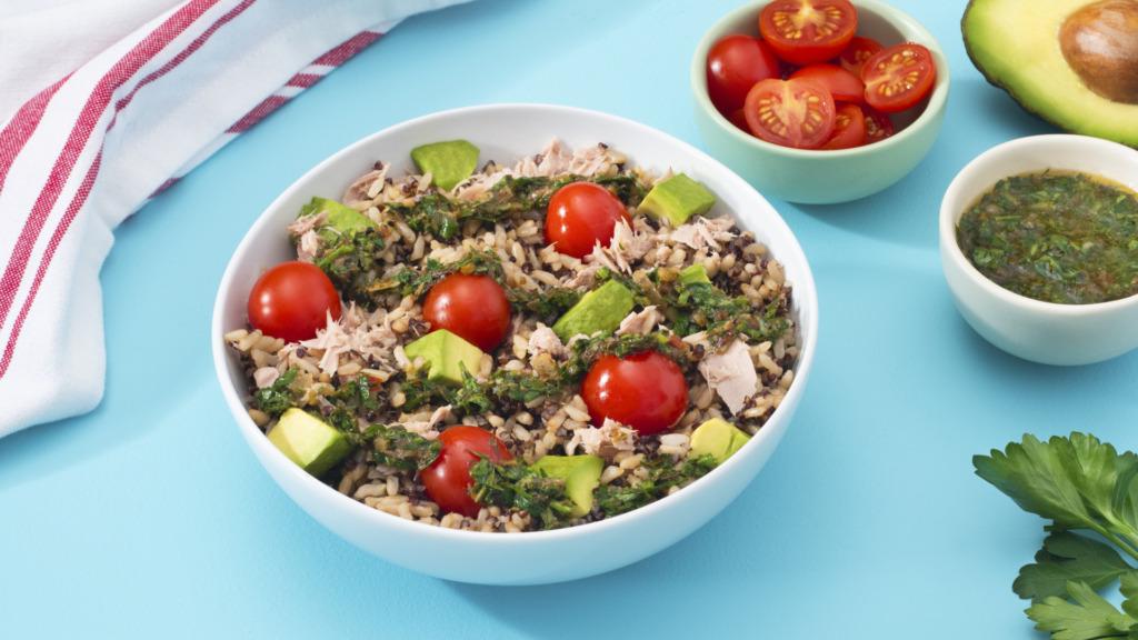 tuna-salad-with-brown-rice-quinoa-cherry-tomatoes-avocado-and-chimichurri-sauce