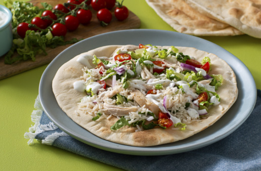 chicken-shawarma-with-jasmine-rice-served-over-a-pita-bread-with-tomatoes-and-red-onion